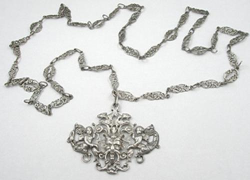 Newly Added Peruzzi Ornate Silver Demon Necklace